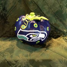 Seahawks pumpkin I painted and added bling with sequins! Papier mâché pumpkin from the craft store.