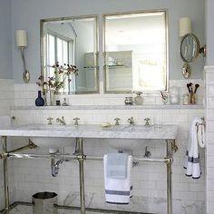 BHG - bathrooms - marble top bathroom vanity, bathroom vanity with marble top, marble washstand, blue gray walls, blue gray bathroom walls, inset medicine cabinets, marble subway tile, marble subway tile backsplash, marble subway tile bathroom, ruhlmann single sconce, ruhlmann sconce. 3 leg washstand, white marble double washstand, marble double vanity, 3 leg washstand, greek key towels,