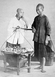 1860 Chinese fruit sellers photographed in the 1860's by John Thomson for the China Magazine