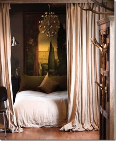 An eclectic and beautiful bedroom. Again I love the idea of using drapes as dividers.