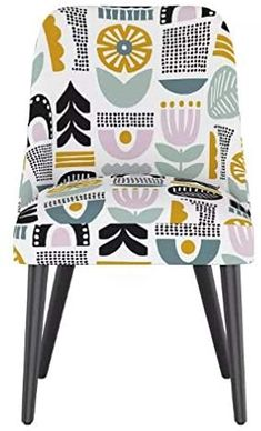 Bring a level of midcentury modern flair and sophistication to your dining room. This upholstered counter stool is covered with a beautiful pattern to add a splash of texture and color to your existing kitchen or dining decor. A black finish on the leg brings in a comfortable sleek vibe that pairs perfectly with the handcrafted upholstery. Dining Decor, Dining Chairs, Dining Room, Counter Stools, Beautiful Patterns, Midcentury Modern, Accent Chairs, Upholstery, Mid Century