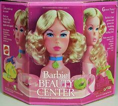 beauty shop barbie head.  I got this for Christmas when I was 6.  The blue eye shadow was horrible!