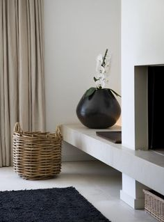 contemporary country | simple fireplace | log basket | linen curtains and large black gloss pot with orchid|| #ontwerp, #architect #RTLWoonmagazine
