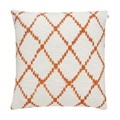 Ikat Kerela Jaffa Orange Cushion: Swedish-designed, India-manufactured simple, colorful and contemporary style cushions.  The company uses an ethnic vibe that is a fusion of both modern and ethnic styles, a mixing of old and new.   All products are handmade. Any imperfections are a part of the beauty.