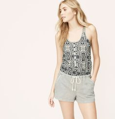 """Pairing an artful mosaic print bodice with a pinstriped bottom, this one and done piece always makes waves. Scoop neck. Sleeveless. Elasticized drawstring waist. Slash pockets. Racerback. 2 1/2"""" inseam."""