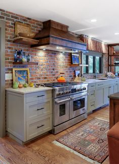 This kitchen features Milwaukee Thin Brick, a product from Glen-Gery's Caledonia Plant in Ohio. Add an exposed brick wall to your home with Glen-Gery thin brick! Custom Kitchen Cabinets, Kitchen Cabinet Design, Kitchen Redo, Kitchen Backsplash, New Kitchen, Kitchen Remodel, Backsplash Ideas, Kitchen Ideas, Rustic Kitchen