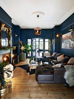 43 Cozy And Relaxing Living Room Design Ideas. Living room is a fundamental part of the house where we gather with our family. In that room we can […] Dark Living Rooms, Living Etc, New Living Room, Living Room Interior, Blue And Copper Living Room, Copper Decor Living Room, Small Living, Modern Living, Blue Living Room Walls