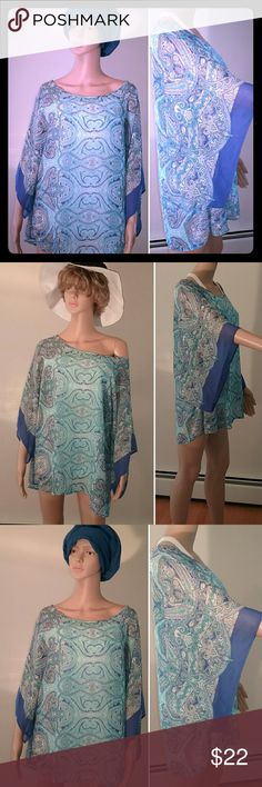 Sheer Paisley Ponco or Cover-Up from Dress Barn Chic sheer poncho with paisley print in beautiful shades of blue is waiting for you. Pair with a cami for the office,  wear over a bathingsuit as a cover-up at the beach, or toss on over a sundresd or with jeans for a boho look on festival days. This item is pre-owned and very gently used. It is in excellent condition. Dress Barn Tops