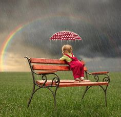 Lovely snapshot of bench, child and rainbow!!