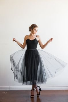 The Dylan - A two piece designed with versatility in mind. Dylan features a Ponte Roma fitted dress, with adjustable silk straps, fully lined, with a center-back zipper. Her whimsical, detachable skirt is made from 3 layers of tulle (only 3, we want to see that shape underneath!).