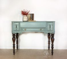 Restyled Vintage Ladies Spinet Desk using General Finishes Persian Blue Milk Paint and Van Dyke Brown Glaze. Legs refinished using Java Gel Stain. Hand painted antique furniture by Delilah Tree