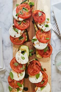 This caprese salad features ripe tomatoes, fresh mozzarella and grilled zucchini. In other words, it's basically summer on a plate. — via @PureWow