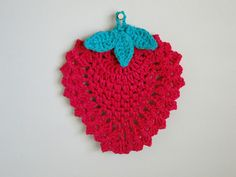 Pretty strawberry potholder by plus3crochet. Pattern used is the free Pear Trivet pattern by April Moreland here http://www.ravelry.com/patterns/library/pear-trivet