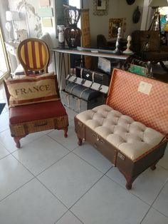 Old suitcases re purposed into ottomans for seating use!