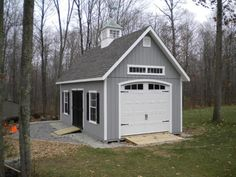 Craftsman style shed with transom window and great door style. Cupola to match garage.