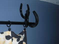 Horseshoe bracket for curtain rod holder