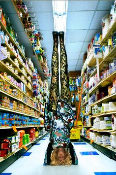 headstands in aisle 3. via Dossier