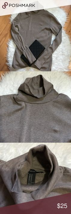 🌼 NWOT Taupe Turtle neck shirt I wish this could still fit! It's new and been sitting in my closet! It's a beautiful oatmeal taupish color. Pair perfect with a long black vest. I'm in clear out mode. I counter with my lowest on one item offers and cheaper deals on bundles 💕 Forever 21 Tops Tees - Long Sleeve