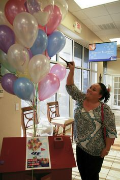 Our guest popping balloons for a chance to win prizes at our recent Business After Hours event.