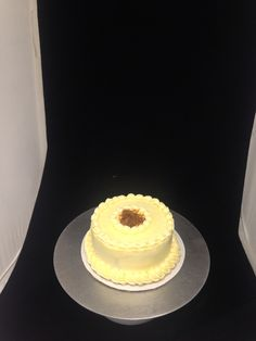 Genoise cake with raspberry jam filling and pate a bombe buttercream with simple fuilletine decor