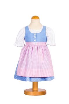 "Tostmann - Made in the in-house manufacture of Tostmann this children's Dirndl ""Liesbeth"" is the so called little sister of the model ""Liesl"" for grown-ups. The body is made of light-blue linen and is therefore particularly carefree. Due to the generous seam allowance the Dirndl can grow with the child up to two years. A perfect gift for birth or baptism.Shop now https://boulesse.com/en/product/2303/Tostmann/Childrens-Dirndl-Liesbeth"