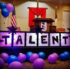 I reused these light boxes made out of air filters that are tapped together with black duck tape. I cut out black letters, laid the boxes horizontally and you have a great background. Church talent show.
