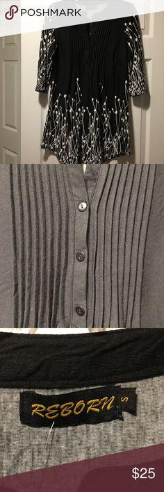 Reborn Black & White Tunic NWT Reborn black tunic with white mod design. Pin-tuck, button placket. 96% rayon, 4% spandex. Reborn Tops Tunics