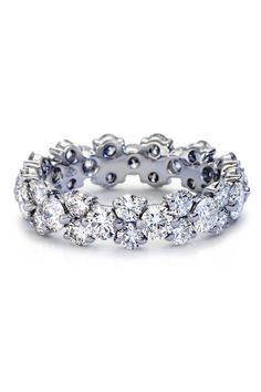 Perfectly stunning, this diamond eternity ring features round diamonds prong-set in pairs and singles creating a continuous band. The design is low profile to wear with your choice of engagement ring setting.