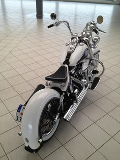 Twin cam Harley Davidson in white  with full wrap rear fender, relocated rear turn signals, solo seat sprung solo seat sprung seat, custom Vance  & Hines exhaust, mini ape hanger handle bars mini ape hangers #harleydavidsonsoftailheritage