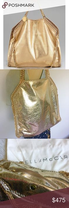 "Stella McCartney Falabella Gold NO TRADES! Medium Gold metallic vegan material. Golden 3 chains trim, top handles with 5"" drop ""Stella McCartney"" charm hangs from top handles. Slouchy, yet structured body may be folded over and carried like a clutch. Dipped top with magnetic-snap closure. Pink Fabric lining; inside zip pocket. 14"" square x 4""D. Includes Stella McCartney card, attached coin purse and  Dustbag. SERIOUS BUYERS ONLY!! DO NOT WASTE MY TIME Stella McCartney Bags Satchels"