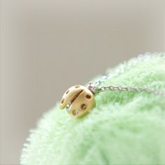 Tiny LadyBug Necklace by laonato on Etsy, $14.00 -- because who doesn't need a little luck and love in their life? <3