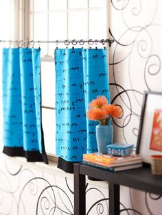 Quick and easy, you can sew up these cafe curtains in an afternoon. Fusible webbing makes it a new sew window update.