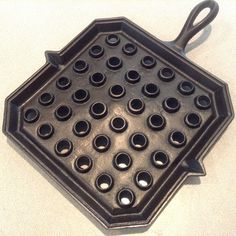 Unmarked square broiler.  Bottom gated.  Patent Feb 26, 1878