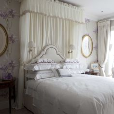 The Guest bedroom at Nina Campbell's house. The wallpaper is Barrington from the Montacute collection