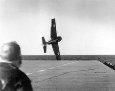 An FM-2 Wildcat in trouble immediately after take-off from USS Sable Great Lakes USA May-June 1943.