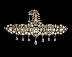 Turban Ornament (sarpesh). Date: 1825–75. Geography: North India, Jaipur. Medium: Gold, set with diamonds; enamel on reverse.