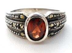 "Vintage 925 Red Gemstone Rings - This is a sterling silver ring/band with an oval 1 carat garnet surrounded by marcasite. It is a size 6.5, hallmarked 925, weighs 4 grams and is almost .38"" at widest"