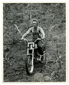 STEVE McQUEEN 8.25x10 still '69 riding a high powered motorcycle off road with no shirt!