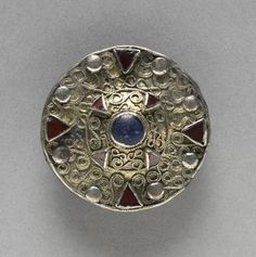 Filigree Disk Brooch with Central Boss, late 600s  Frankish (late Merovingian), 7th century  gilt silver, copper alloy, glass, almandine, Overall - h:4.20 w:4.30 d:1.80 cm (h:1 5/8 w:1 11/16 d:11/16 inches). Andrew R. and Martha Holden Jennings Fund 2007.163