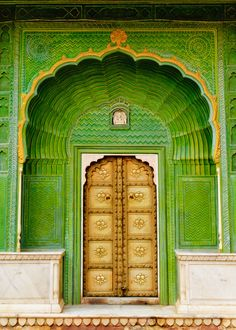 "One of the four gates at Pritam Chowk in the City Palace, Jaipur, India. Each gate represents one of the four seasons. The Green Gate, also called Laheriya (meaning: ""waves"") Gate, represents spring. Cool Doors, Unique Doors, When One Door Closes, Closed Doors, Door Knockers, Doorway, Stairways, Windows And Doors, Monuments"