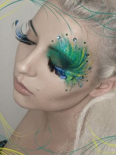 Google Image Result for http://popularchick.com/wp-content/uploads/2012/02/peacock-style-makeup.jpg