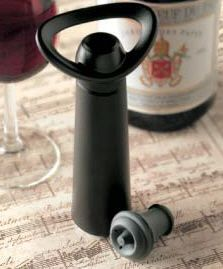 Vacu Vin Concerto Wine Saver with 4 stoppers - Item 1229 -Vacu Vin Concerto Wine Saver. Use in the same way as their ordinary wine saver (Place a stopper in the top of your bottle and pump out the air until you hear the clicks).