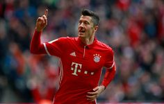 Robert Lewandowski Photos Photos - Robert Lewandowski of Muenchen celebrates after he scores the opening goal during the Bundesliga match between Bayern Muenchen and FC Schalke 04 at Allianz Arena on February 4, 2017 in Munich, Germany. - Bayern Muenchen v FC Schalke 04 - Bundesliga