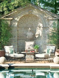 Wall niche with urn -- planted or as a fountain. Like the round balls at the pool corners