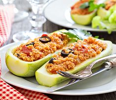 Zucchini Boats A delectable, healthy dish! Ingredients      1 lg. zucchini     1/2 c. rice     1/2 lb. ground turkey     1 onion, diced     1 green pepper, diced     2 cups tomato sauce     Grated Mozzarella cheese     Salt & pepper