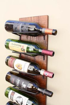 Our rustic wall wine rack will stylishly show off your wine collection. All custom made of durable wood and handmade cradles this wine rack will display your wine bottles at the perfect tilt as it complements your kitchen, dining or living room décor. Makes a great gift. - Made from