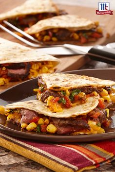 Cantina Stea Quesadillas w/Skillet-Charred Corn Salsa - Stuck in a dinnertime rut? Serve quesadillas filled with marinated steak, shredded cheese and a colorful salsa of lightly charred corn, bell pepper and onions. From McCormick Recipes Quesadillas, Steak Quesadilla, Beef Recipes, Mexican Food Recipes, Dinner Recipes, Cooking Recipes, Healthy Recipes, Ethnic Recipes, Cooking Tips