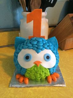 The perfect owl smash cake! Boy or girl first birthday!! Green, blue, orange! First birthday cake.