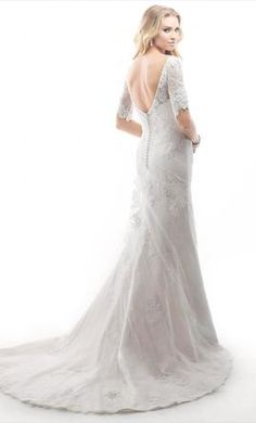 Maggie Sottero  Theda: buy this dress for a fraction of the salon price on PreOwnedWeddingDresses.com
