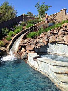 Pool Designs With Rock Slides texas custom moss rock waterfall with beautiful water slide Hillside Water Slide